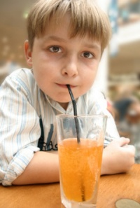 boy-drinking-soda-through-straw
